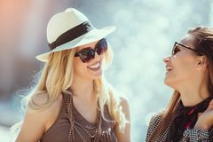 Happy women talking and laughing, having fun. Outdoor royalty free stock photography