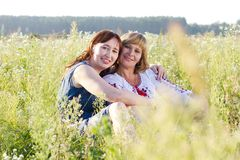 Happy women talking and laughing in nature with a green background Stock Photography