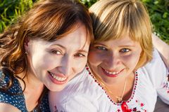 Happy women talking and laughing in nature with a green background Royalty Free Stock Images