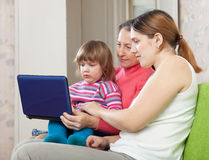 Happy women  of three generations with laptop Stock Images