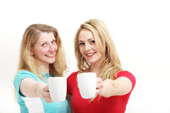 Happy women toasting with coffee Royalty Free Stock Photography