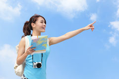 Happy women traveler pointing Royalty Free Stock Photo
