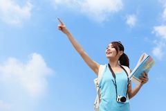 Happy women traveler pointing Royalty Free Stock Photos