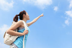 Happy women traveler pointing Royalty Free Stock Image