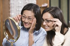 Happy Women Trying Out Spectacles Royalty Free Stock Photography
