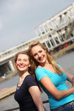 Happy women on an urban waterfront Royalty Free Stock Photos