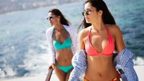 Happy women on vacation having fun on beach in summer royalty free stock photography