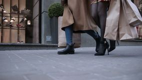 Happy women walking city street with shopping bags stock footage
