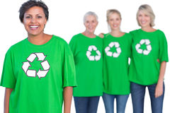 Happy women wearing green recycling tshirts Stock Image