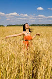 Happy women in the wheat Stock Photo
