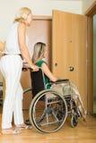 Happy women in wheelchair Stock Photos