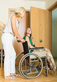 Happy women in wheelchair Royalty Free Stock Photography