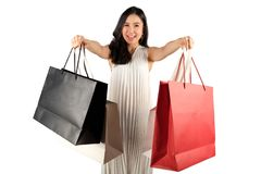 Shopping woman with a shopping bags. A happy woman with a shopping bags on white background royalty free stock image