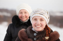 Happy women in winter Royalty Free Stock Photo