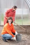 Happy women works at greenhouse Stock Image