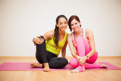 Happy women in a yoga studio Royalty Free Stock Image