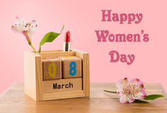 Happy Womens Day background with calendar and blossom. Happy Women`s Day or International Womens Day celebrated on March 8th. Pink background image with wooden stock photos