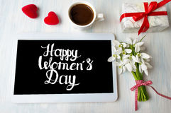 Happy womens day calligraphy note on a tablet. Happy womens day calligraphy note on a white tablet royalty free stock image