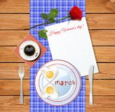 Happy womens day greeting card with number 8 shaped fried heart. Eggs on plate and cup of coffee on wooden background with tablecloth and clear sheet with copy stock illustration
