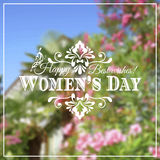 Happy Womens Day. 8 March  on unfocused floral Stock Photo