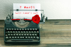 Happy Womens Day vintage typewriter paper red rose flower Stock Images