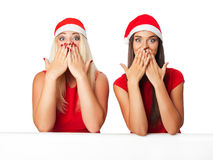 Happy womens in santa helper hat with blank white board Royalty Free Stock Photo