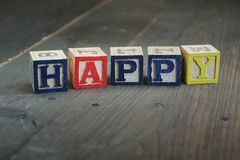 Happy wood blocks Stock Images
