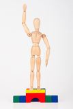 Happy wood mannequin stand on podium Royalty Free Stock Photo