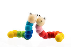Happy wooden baby toys worms isolated on white. Happy wooden baby toys, two worms isolated on white background royalty free stock images