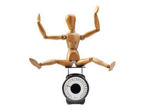 Happy wooden dummy and measuring instrument Stock Images