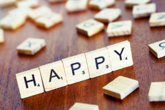 Happy word on block concept, letters placed on a desk in preciou Stock Photos