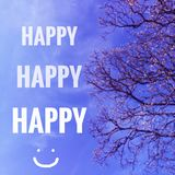 Happy words on blue sky. Words `Happy` on blurred sky and tree background Stock Images