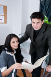 Happy Work Place. Two Happy and attractive people at work. Shot with Hi Res Camera stock photo