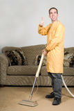 Happy Worker. A happy worker cleaning the carpets and giving the camera a thumbs up Royalty Free Stock Image