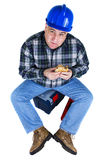 Happy worker eating a hamburger. Happy worker eating his hamburger and looking up. White background Royalty Free Stock Photography