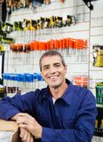 Happy Worker In Hardware Shop Stock Photography