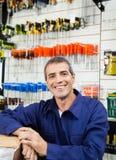 Happy Worker In Hardware Shop. Portrait of happy mature worker in hardware shop Stock Photography