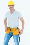Happy worker holding hammer over white background Royalty Free Stock Image