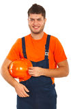 Happy worker holding helmet Royalty Free Stock Images