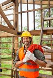 Happy Worker Holding Pipe In Incomplete Wooden Royalty Free Stock Photo