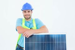 Happy worker leaning on solar panel Stock Photo