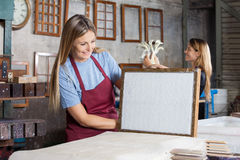Happy Worker Looking At Dried Paper On Mold In Royalty Free Stock Photos