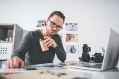 Happy worker looking at images royalty free stock photography