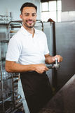 Happy worker making coffee. In the bakery Stock Images
