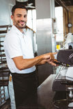 Happy worker making coffee. In the bakery Stock Photography