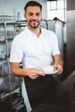 Happy worker making coffee. In the bakery Royalty Free Stock Photos