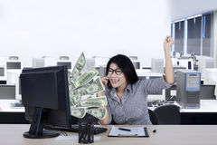 Happy worker with money on the monitor Stock Photography