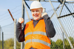 Happy worker at outdoors near the fence Stock Photos