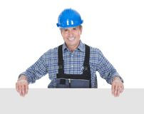 Happy worker pointing on placard Royalty Free Stock Photo
