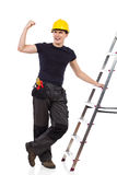 Happy worker posing with a ladder Stock Images